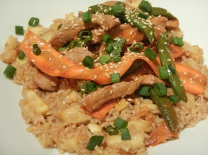 Pork Stir-Fry With Carrots and Sugar Snap Peas Over Pineapple-Ginger Brown Rice