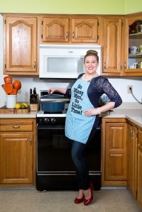 "Modeling my favorite apron, which happens to be my Great Grandma's that reads, ""so many men so little time""! Picture courtesy of Billy Bass Photography. All rights are reserved."